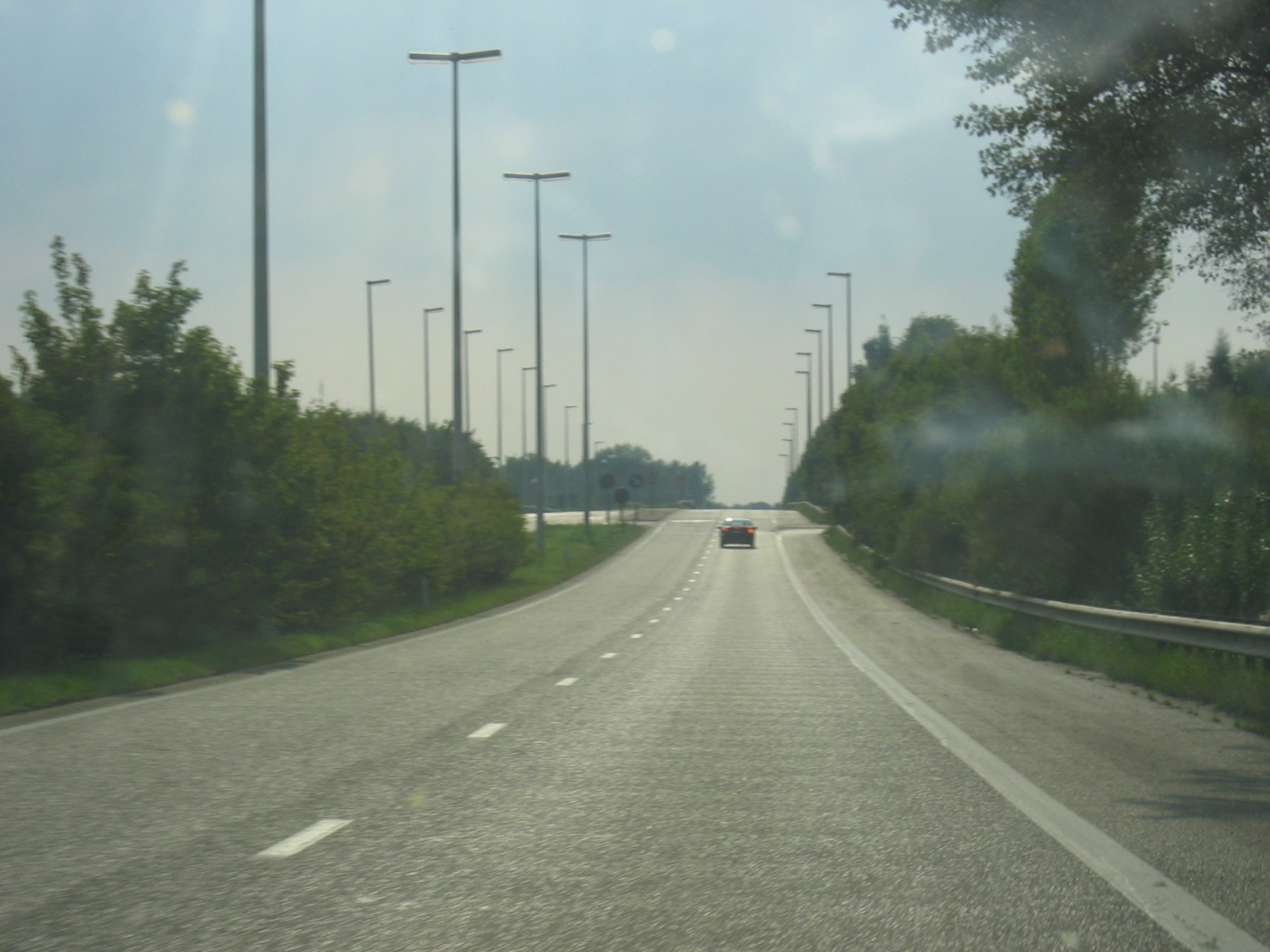 The short section of N73 that is in use, driving east, towards the overpass over the E313