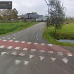 The former road on Google Street View. Now gone, except for the bike path junction